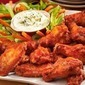 Roasted spicy chicken wings with goat cheese dip